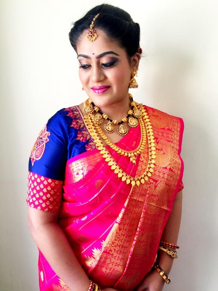 Special occasion makeup and hair perfected by Swank Studio. #hairstyle #silksaree #jewellery #SareeBlouse #SariBlouseDesign   Find us at https://www.facebook.com/SwankStudioBangalore