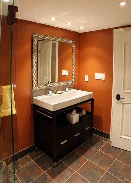 burnt orange bathroom......love the wall color, tile and color of the vanity......maybe a different style vanity, sink and mirror....