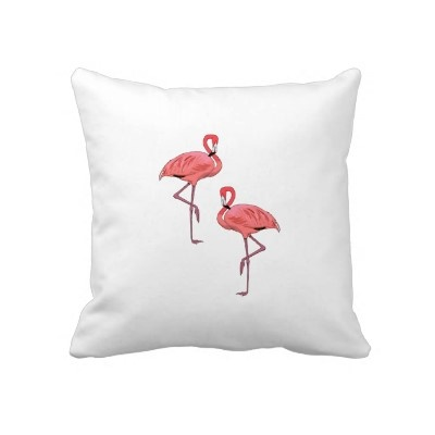 Pink Flamingo Pair throw pillow. Our favorite pink feathered friends are coming to take over your decor. Classic flamingo kitsch suits any tropical room. Sure to make you smile. Break them out at the beach party for an extra fun time. Tropiques carries three coordinating pink flamingo pillows plus an array of other decor and party items.