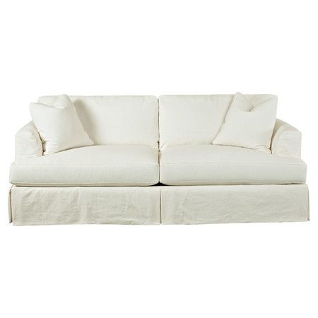 Chaise Sofa Display bright pillows and a cozy fringed throw with this slipcovered sofa featuring white cotton upholstery and down filled cushions