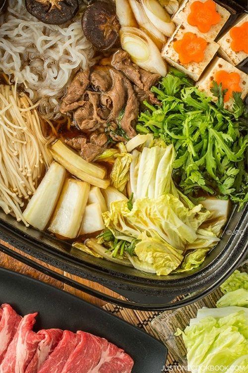 Sukiyaki (すき焼き) is a popular Japanese hot pot dish which is often cooked and served at the table, similar like Shabu Shabu (しゃぶしゃぶ).