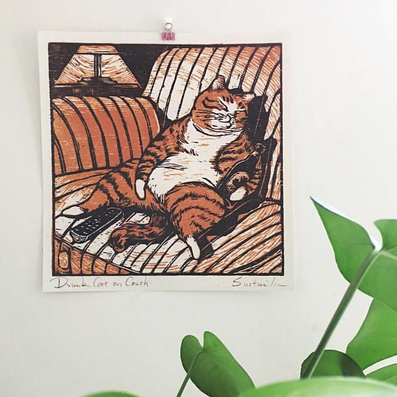 Drunk Cat on Coach  From Canada  Sizes: Posters are digital printed on paper, thick & Matte paper. Perfect to frame it and hang on wall, or just pin/tape on wall. Artists of Horse Fiddle Press: Sustai Ulanbaagen ( sustaiart.com )  Original image is 2 layers woodcut printmaking on paper, also available link in bio. Ship with card board Envelope  Shipping Timeline: US: 1-5days Canada: 1-10days, depends how far from Toronto International: 2-4weeks