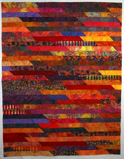 By Judy Damon. This is probably my favorite of all the 1600 quilts I've seen, although of course I have yet to see one that I wouldn't love to have in my home. I'll have to do one someday - so fun.