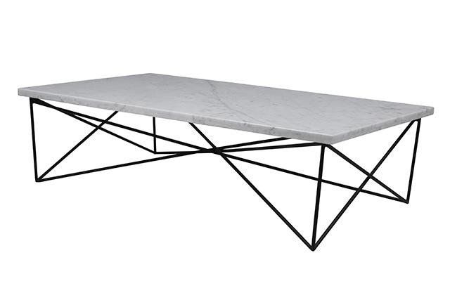This coffee table features a stunning large piece of matt white marble atop a geometric base. This structural interest creates a level of three dimensionality, adding sophistication to your scheme.
