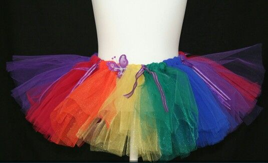 Rainbow tutu, satin ribbon and butterfly detail.