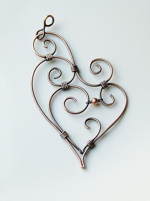 A 'Wire Heart' - I really like the swirls, and the fact that it's wire looks really neat - but this would be extra pretty with a bit of the superfluous 'noise' swirls toned differently, and the main heart accented... of course I don't do jewellery, so I'd do it as an image.