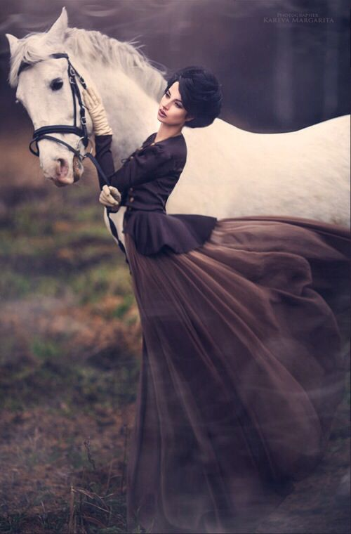 Haute couture drees brown horse editorial pose fashion model