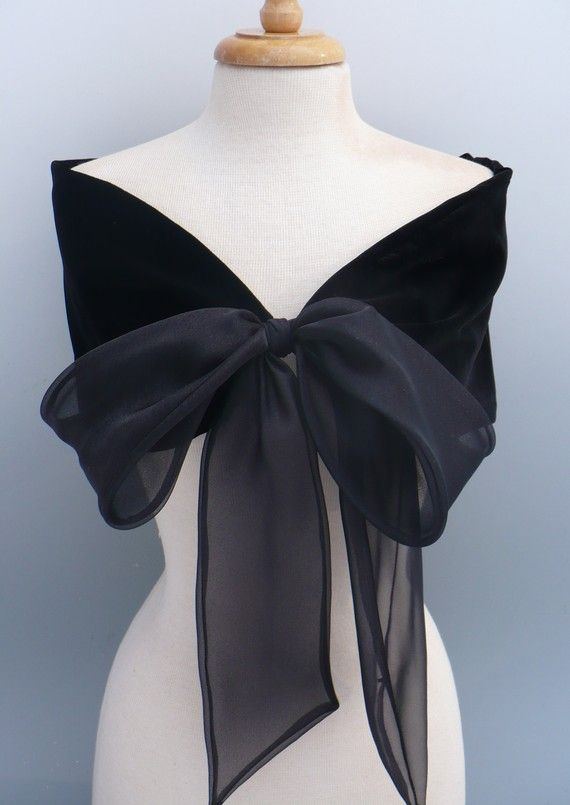 Black velvet stole tied with black organza bow. The velvet is silk rayon and the bow is nylon organza. Very elegant yet simple and easy to wear. Does need to be dry cleaned. The small size is, 38 long between the bow and 8 wide.  Medium, is 40 x 8 wide.  Large, 42x 8  Extra Large, 44  x 8  Over time this stole can become an heirloom piece. A perfect accesssory that will go with many styles, new and vintage. I can also make this piece in beautiful white velvet, a perfect piece for a winter…