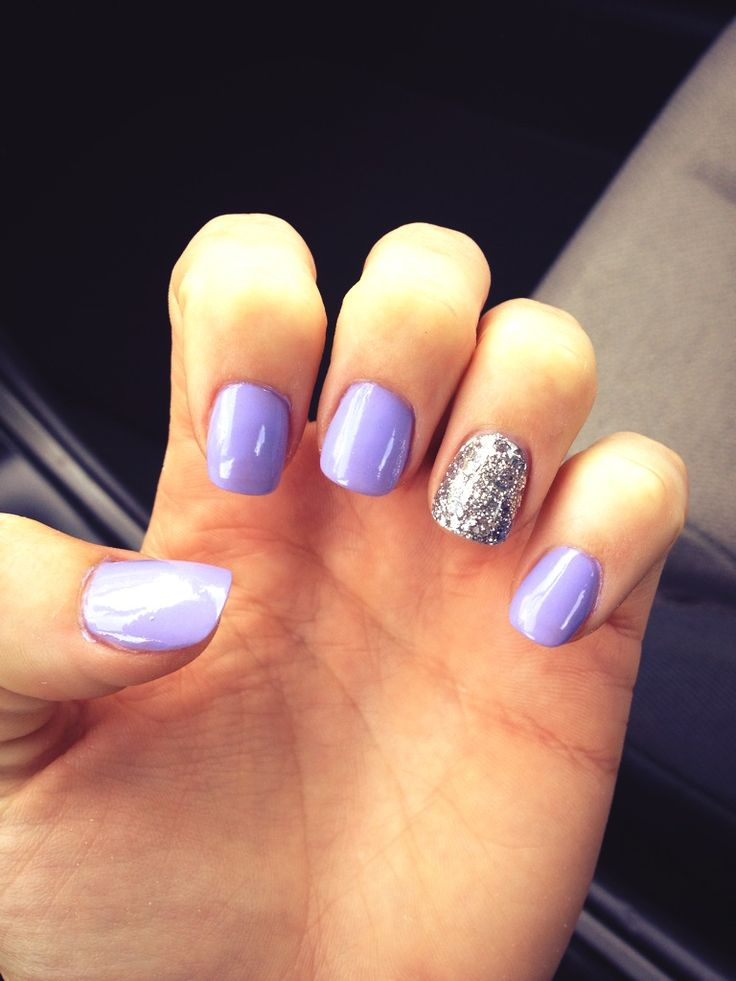 light purple + glitter accent nails.                              …