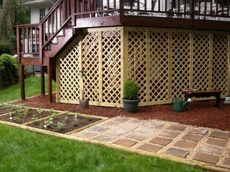 Turn the open space underneath your deck into closed storage by creating a lattice wall with a gate.