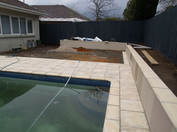 Garden wall and paved pool surround