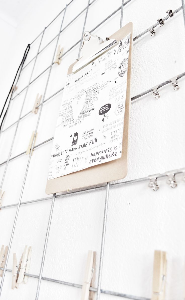 Inspiration only Wire grid wall. Place above a desk in a small office. Clip on notes, mementos, etc. using metal clips or clothes pins.
