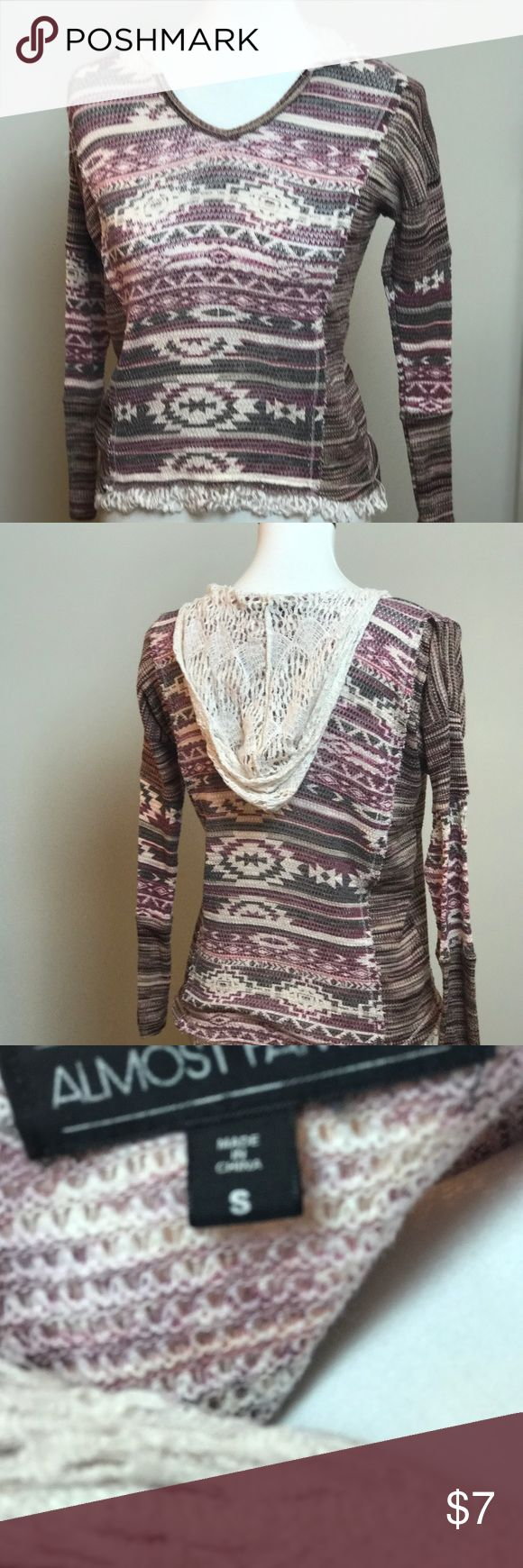 """Super cute long  sleeve Aztec hoodie with fringe. Super comfy slightly used Aztec hoodie by """" almost famous. Made of 100% polyester . Lace like hoodie keeps it light , fringe hem completes the look ! Almost Famous Tops Sweatshirts & Hoodies"""