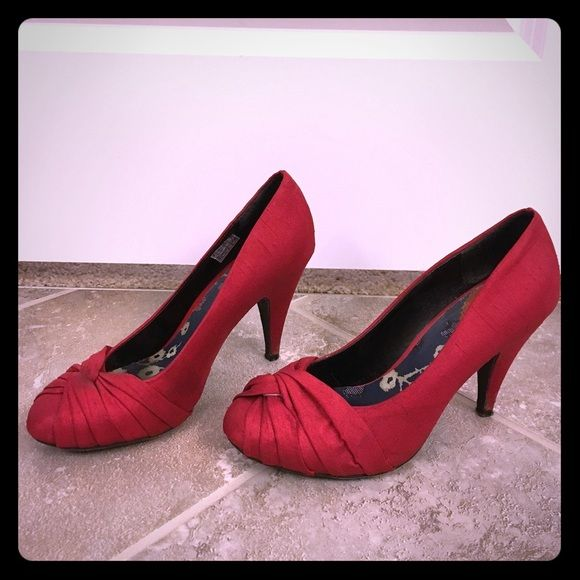 Red High Heel Shoes Beautiful red closed toe high heel shoes.  Minor wear and tear to heels. Rocket Dog Shoes Heels