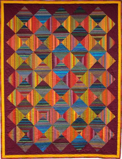 i like the effect this quilt has with the stripes going opposite ways, and having 2 sets of colors