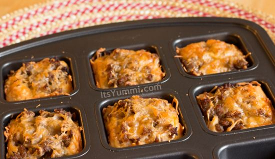 3 ingredients and a  PC Brownie Pan make up these Cheese & Sausage Biscuits from ItsYummi.com #recipe #breakfast #PamperedChef