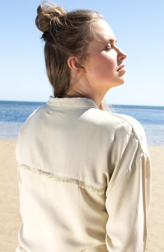 The Knot Top - Sandy Beige - is the staple of knotted shirts. Made in a flattering rayon fabric, it features fringed details on pockets and back... Made with love in Bali.