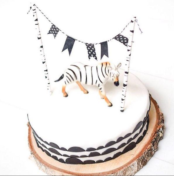Monochrome zebra birthday cake black and White with a masking tape garland.