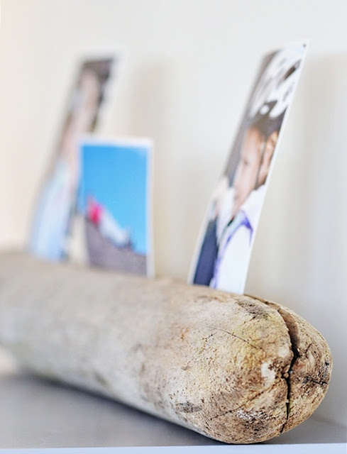 DIY drift wood as photo holder.
