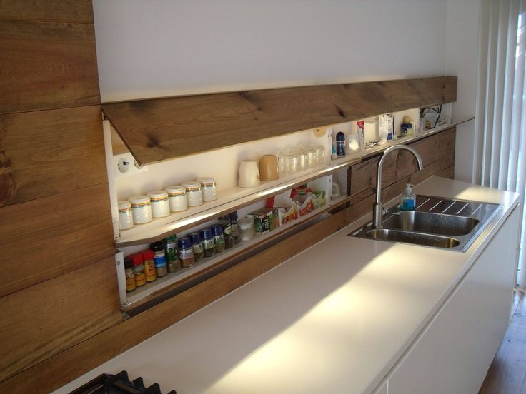 Best 25 hidden kitchen ideas on pinterest sliding room for Hidden kitchen storage ideas
