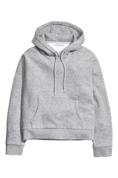 Hooded sweater: Top in sweatshirt fabric with a lined drawstring hood, long sleeves, dropped shoulders, a kangaroo pocket at the front and ribbing at the cuffs and hem. Soft brushed inside.