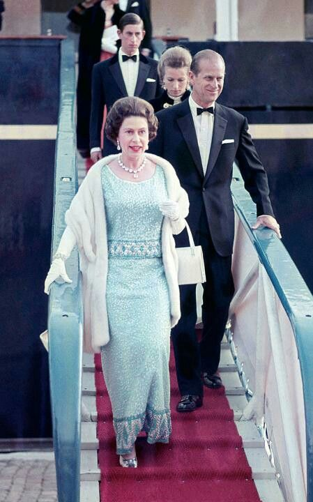 Queen Elizabeth II and Prince Philip with Prince Charles, and Princess Anne disembark from the Britannia during a state visit to Norway on August 7, 1969.