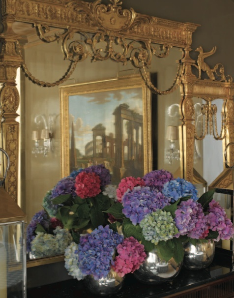 """'If you sit with your back to the cabinet, you face another gilded mirror. The two mirrors reflect each other, visually multiplying the space.' -""""Elegant Rooms That Work"""", Dining Rooms"""