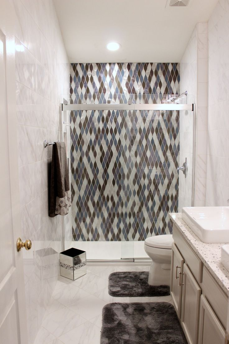 This Guest Bath Features A Stunning Shower Accent Wall, Floor To Ceiling  Tile Walls, Recylced Glass Countertops And Fixtures By Kohler  @kohlerco,  ...