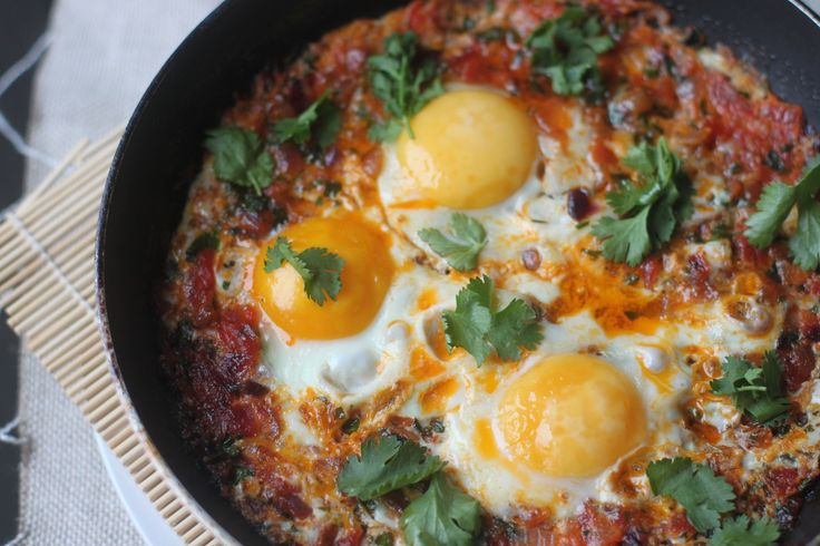 Algerian Chakchouka, North African eggs pouched in a tomato sauce.