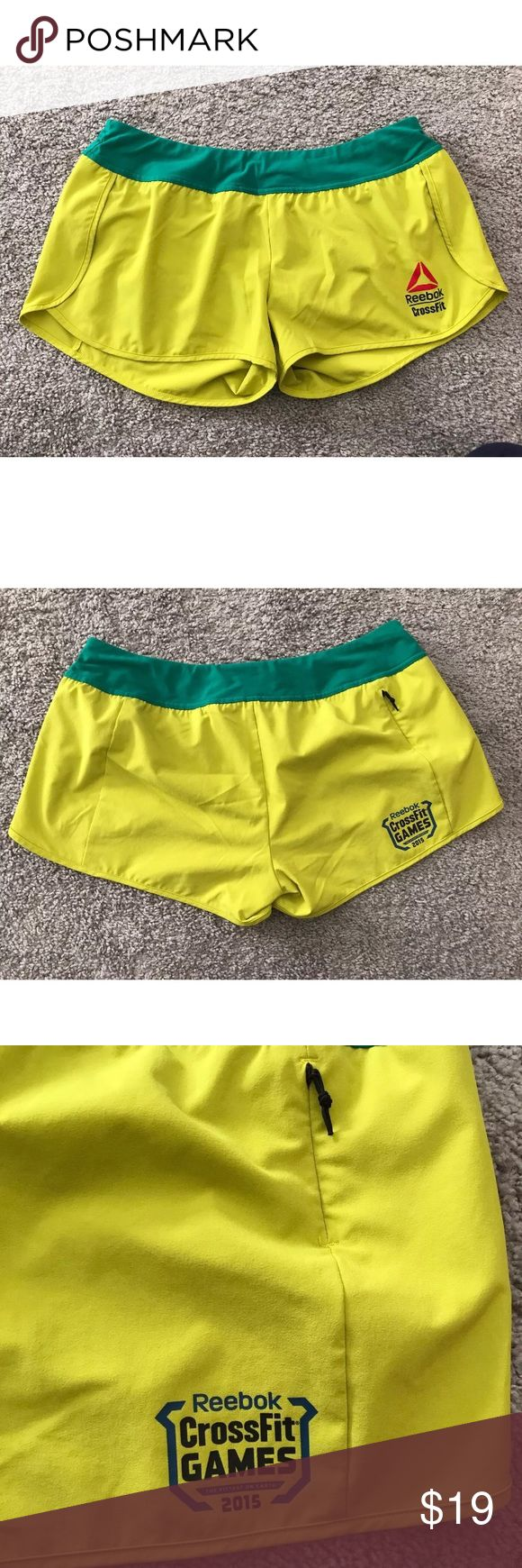 Reebox crossfit games  the fittest on earth short Reebox crossfit games 2015 the fittest on earth yellow green women's shorts in size large. Has a small back pocket. Recycled polyester/Spandex. In great preloved condition. Reebok Shorts