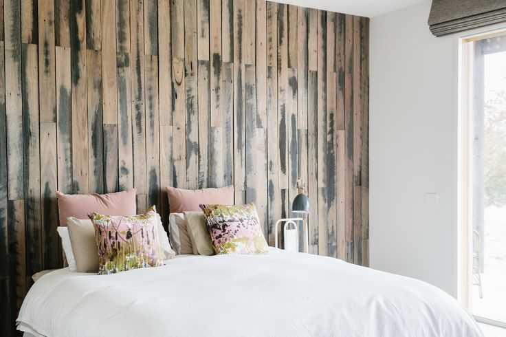 Feature wall in our bedroom---recycled timber fence palings