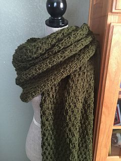 2 skeins are needed, and the shawl is knit using two strands at once size 17 needles! ...... WOW talk about quick knit