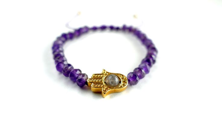 Macrame bracelet from Amethyst,a gold plated Fatima's hand with a Labradorite stone and gold elements Price:33€