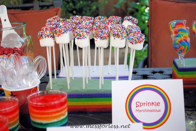 Marshmallow pops, marshmallows with sprinkles Dip marshmallows in water and roll in sprinkles