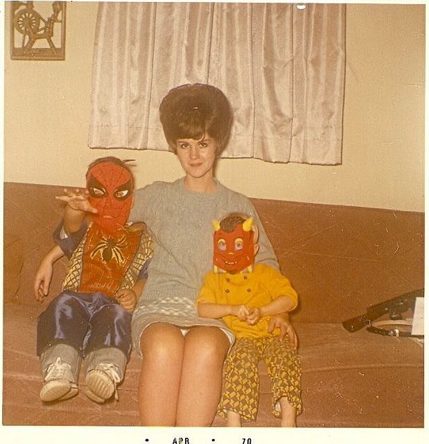 Vintage photo of Halloween trick or treaters in Spiderman & goblin masks & costumes with mom in a beautiful bouffant