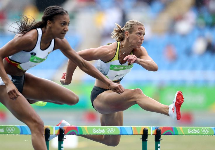 Jennifer Oeser of Germany and Nafissatou Thiam of Belgium compete in Women's Heptathlon 100 Meter Hurdles on Day 7 of the Rio 2016 Olympic Games at the Olympic Stadium on August 12, 2016 in Rio de Janeiro, Brazil.