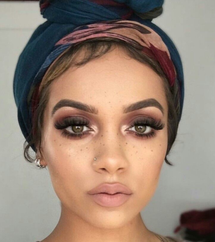 This make up is far from subtle, but she can carry it off because she resembles a doll - full lips tiny nose, big round eyes & YOUNG