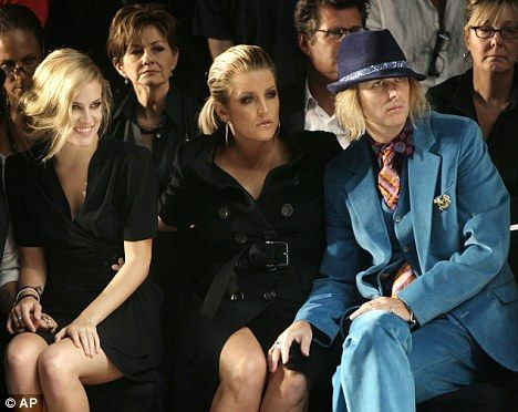 Lisa Marie Presley, center, her daughter Riley Keough, left, and her husband Michael Lockwood