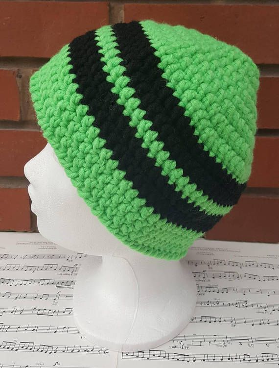 This is a hand crochet hat made in snuggly yarn. An adult hat, suitable for a large head and very comfortable if you have a lot of hair like me! A neon green hat with black stripes. A perfect gift for anyone in your life, or why not treat yourself. The simple crochet beanie design means it this winter hat is suitable for a woman or man. Made from chunky yarn composed of 70% acrylic and 30% wool, it is soft and durable. Made from black and neon green yarn, this is a stylish hat that will…