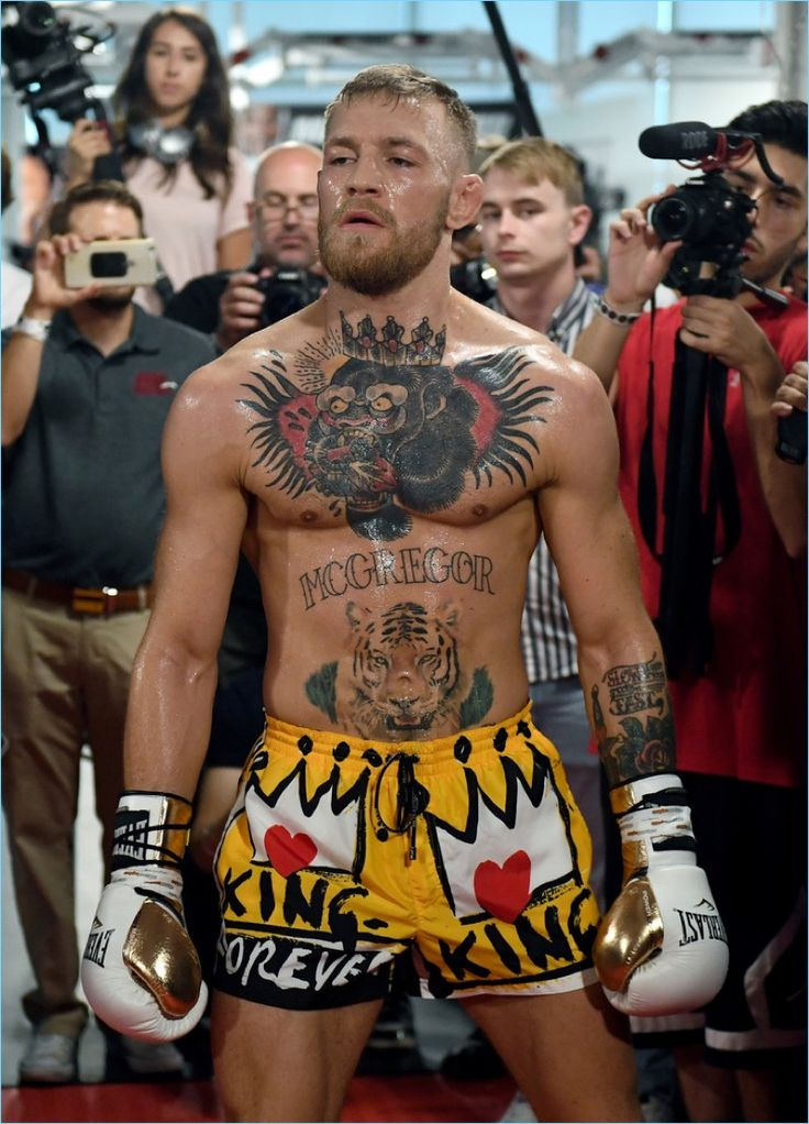 Mixed martial artist Conor McGregor wears yellow Dolce & Gabbana swim trunks for his media workout.