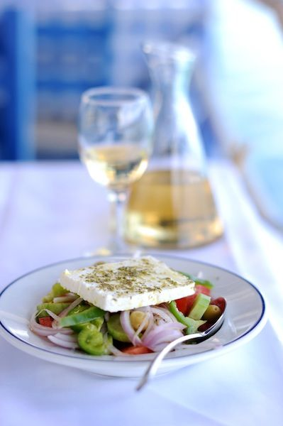 Greek salad is a summer salad dish made with pieces of tomatoes, sliced cucumbers, green bell peppers, onion, sliced or cubed feta cheese and olives, typically seasoned with salt and dried oregano and dressed with olive oil #kitsakis
