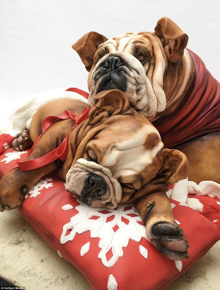 Cake designer Emma Jayne Morris, 46, of Aberdare, south Wales, has created a series of very life-like dog-shaped cakes using just vanilla sponge and fondant icing, including a cuddling bulldog cake