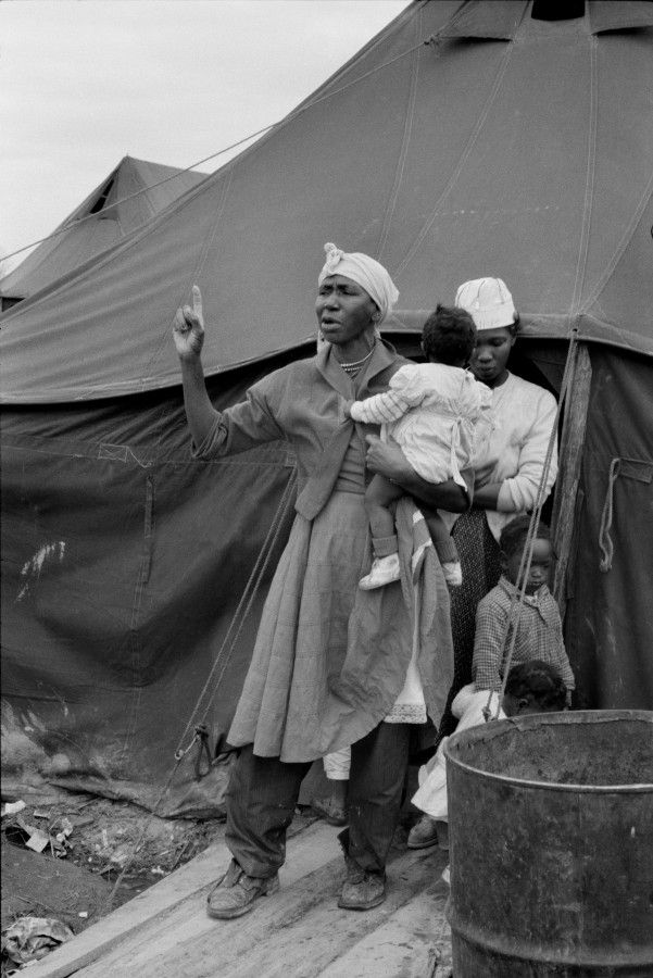 Henri Cartier Bresson -1961  Title: Tent City, Near Somerville, TennesseeTemporary living quarters for African- American sharecroppers who registered to vote and as a result were evicted by white landowners. This woman, fifty eight years old, had picked cotton on the same land since she was eight years old.