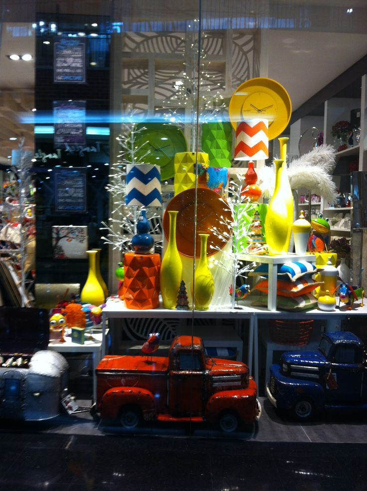 Habitania Penrith. Truck Eskie, colourful lamps and metal stools. Yellow standing vases sets of 3 sizes. Wall art too.