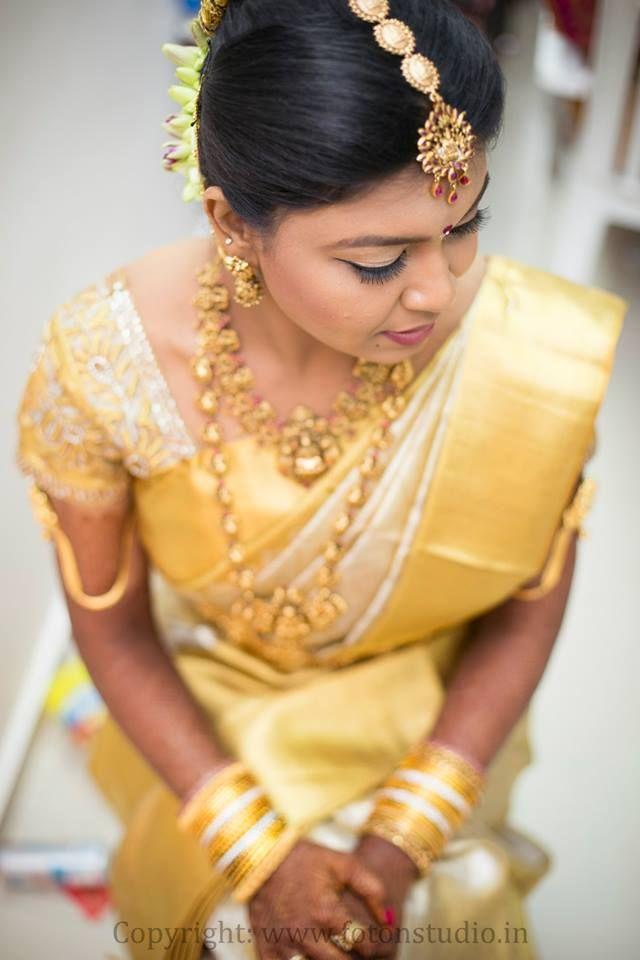 South Indian bride. Gold Kanchipuram silk sari. Temple jewelry. Braid with fresh flowers. Tamil bride. Telugu bride. Kannada bride. Hindu bride.Malayalee bride.