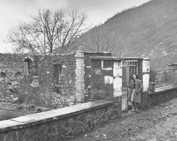 Civil War/Greece A school teacher standing in front of a destroyed school.Location:Louzesti, Greece Date taken:December 1947 Photographer:John Phillips