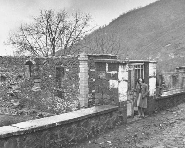 Civil War/Greece  A school teacher standing in front of a destroyed school.Location:Louzesti, Greece  Date taken:December 1947  Photographer:John Phillips