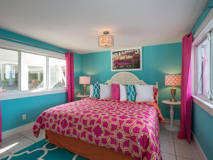 Master Bedroom - This pink themed room allows you to escape to luxury even at night. Listen to the ocean as you drift off to sleep with this waterfront beach villa on Anna Maria Island, Florida.
