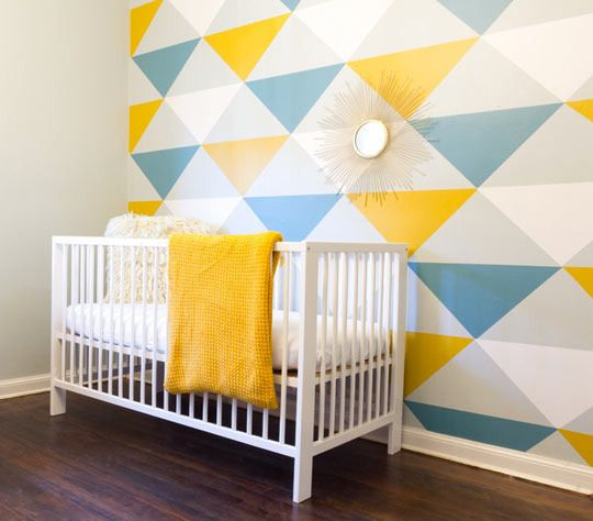 Love this geometric nursery! Blue and yellow and white are perfect together!