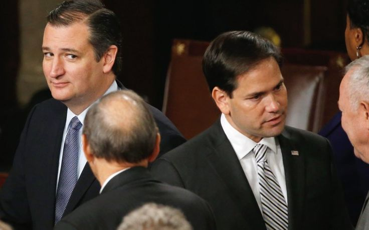 Republican U.S. presidential candidate and Senator Ted Cruz (L) looks over at rival candidate Senator Marco Rubio (2nd R) after Pope Francis' address before a joint meeting of the U.S. Congress in the House of Representatives Chamber on Capitol Hill in Washington September 24, 2015.